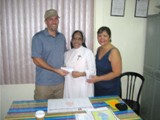 Fiore School in the Philippines - Steve Heintz and Ayo Reyes present donation to Sister Annie