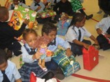 Chicago Holiday Toy Drive - Children at the Chicago Toy Drive enjoy the gifts provided by An Angel�s Calling