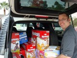 Phoenix ChildHelp Event - George Snyder hard at work unloading all the wonderful donations from An Angel�s Calling