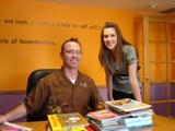 Phoenix New Day Family Center - George Snyder and Jessica Gardner organizing some of the books donated by An Angel�s Calling