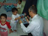 St. Rita's Orphanage - A newly adopted child shows of pictures of his new family.  He is set to go home in just a few short days!