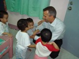 St. Rita's Orphanage - Steve Heintz visits with the orphans at St. Rita's