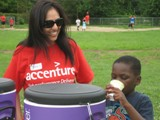 Prerna from Accenture helps ensure the kids stay well hydrated during the Boys & Girls Club event